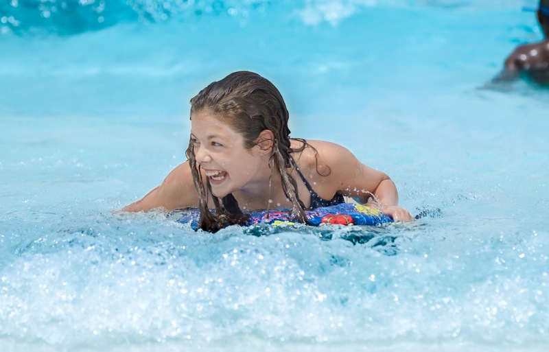 Girl in Wave Pool_leg out.jpg